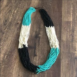 Chunky turquoise cream and black beaded necklace